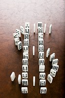 Dominoes forming dollar sign