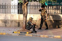 National Security Guard NSG commando taking position opposite Oberoi Trident hotel after terrorist attack by Deccan Mujahideen on 26th November 2008 i...