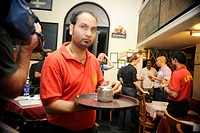 Leopold Cafe waiters ; after terrorist attack by Deccan Mujahideen on 26th November 2008 in Bombay Mumbai ; Maharashtra ; India NO MR