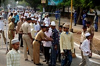 Men arriving for their Eid al Fitr or Ramzan id namaaz at Lashkar_e_Eidgaah ground after security checking , Malegaon , Maharashtra , India NO MR