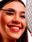 Happy Young Teenager Making Herself Up With Mascara