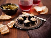 Prunes Stuffed with Foie Gras on a Metal Dish, Bread and Foie Gras, Pickles, Wine