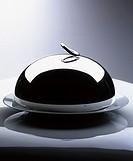 A cloche on a serving platter