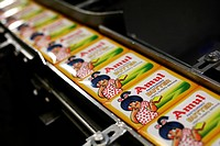 Packed Amul butter in wrappers coming out in Amul factory in Anand ; Gujarat ; India