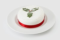 Christmas Cake Decorated with Holly and Red Ribbon