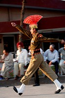 Indian border security force solider doing parade before start changing of guard ceremony at Wagah border ; Amritsar ; Punjab ; India NO MR