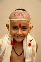 Bald headed eight year old boy on thread ceremony MR721
