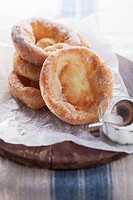 Bavarian_style doughnuts with sugar on baking paper