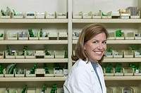 Portrait of a young female pharmacist smiling for the camera