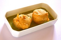 Fast food , batata vada with chutney in tray on white background
