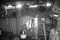 Inside view of hut in Malvani slum , Malad , Bombay Mumbai , Maharashtra , India