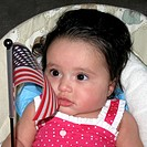 Baby girl holding an American flag