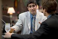 Businessmen Sitting at Restaurant