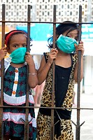 Girls wearing mask avoiding swine flu ; Bombay Mumbai ; Maharashtra ; India NO MR