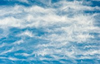 Wavy clouds in a blue sky