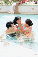 Parents and Daughter in Swimming Pool