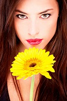 woman and yellow daisy
