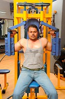 Man exercising in fitness centre MR786