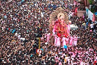 Devotees watching ganesh immersion of lalbaugcha raja in Bombay Mumbai , Maharashtra , India