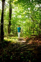 Man walking in forest
