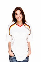 smiling woman wearing football shirt with hands in her pockets