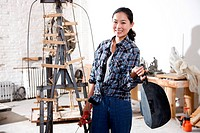 A female artist creating a work in studio