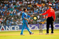 Indian player sachin Tendulkar hand over cap to umpire Simon Taufel before bowling during the ICC Cricket World Cup finals against Sri Lanka played at...