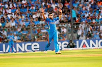 Indian bowler Virat Kohli reacts in his bowling spell during ICC Cricket World Cup finals against Sri Lanka being played at the Wankhede stadium in Mu...