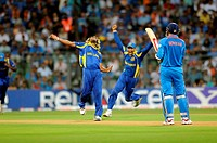 Sri Lankan bowler, celebrate wicket of Indian batsman Virendra Sehwag R during the 2011 ICC World Cup Final between India and Sri Lanka at Wankhede St...