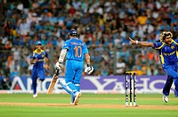 Indian batsman Sachin Tendulkar walk back to pavilion as Sri lankan bowler Lasith Malinga R celebrates his wicket during the 2011 ICC World Cup Final ...