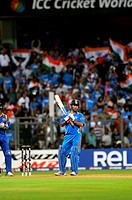 Indian captain, batsman M S Dhoni getting ready to play his shot during the 2011 ICC World Cup Final between India and Sri Lanka at Wankhede Stadium o...