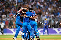 Indian cricketers celebrate after beating Sri Lanka during the ICC Cricket World Cup 2011 final match at The Wankhede Stadium in Mumbai on April 2 201...