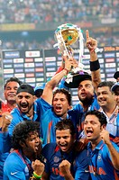 Indian cricketer Sachin Tendulkar c celebrate with the ICC World cup trophy after beating Sri Lanka in the ICC Cricket World Cup 2011 final match at T...
