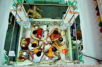People performing Rudrabhishek around Shivling Pataleshwar temple Jodhpur Rajasthan India Asia