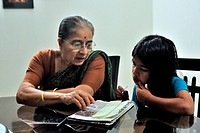 Grand mother taking study of daughter MR556