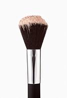Close up of blush powder on makeup brush