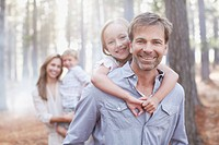Portrait of smiling family in woods