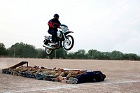 Policeman showing tricks on motorbikes ; Jodhpur ; Rajasthan ; India