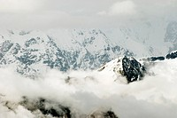 Shining peak Himalayan range of mountain range surrounded with clouds , Uttaranchal , India