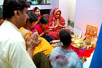 Family performing laxmi poojan in house on Diwali festival ; Jodhpur ; Rajasthan ; India MR704