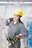 Chinese worker wearing tool belt