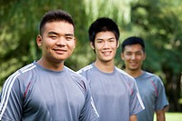 Chinese soccer players standing in park