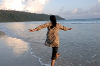 Lady enjoying and playing in water at Radhanagar beach ; Andaman Islands ; Bay of Bengal ; India MR736K 2008