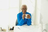 Black businesswoman drinking coffee