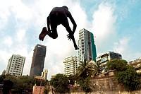 Boy jumping in banganga tank ; Walkeshwar ; Malabar hill ; Bombay Mumbai ; Maharashtra ; India NOMR