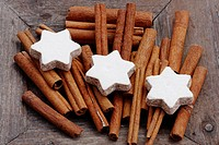cinnamon sticks in wooden bowl - Cinnamomum cassia - cinnamon star cookies at christmas
