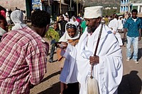 A man is blessed by a Priest in the street during the festival of Timkat, Gondar, Ethiopia