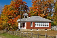 The historic Standard School, at Five Mile Creek along Highway 119 with fall foliage color near Harbor Springs, Michigan, USA