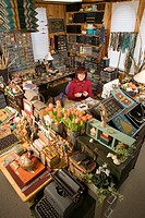 artist craft person in her studio, Keene, NH working with beads and thread and bone, small business, home office