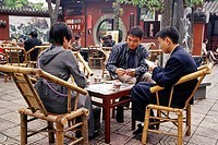Friends playing cards in a teahouse, Great Mercy Temple, Chengdu, Sichuan, China